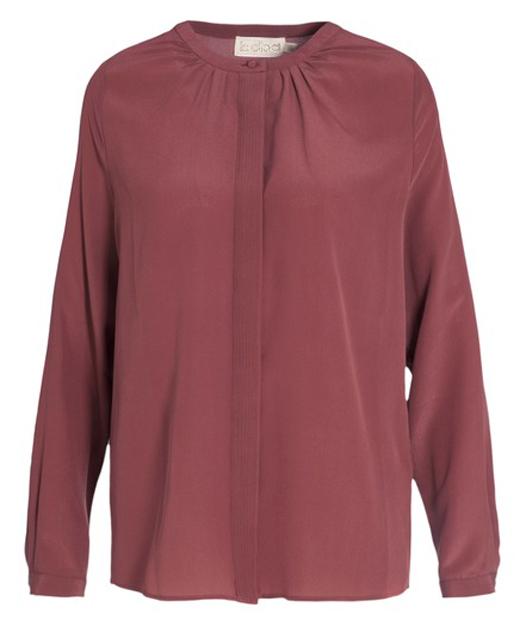faldas midi cómo combinarlas con bdba. Blusa color vino