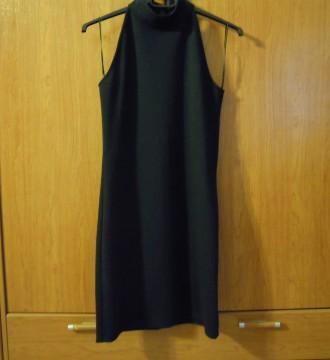 vestido abotonado el cuello