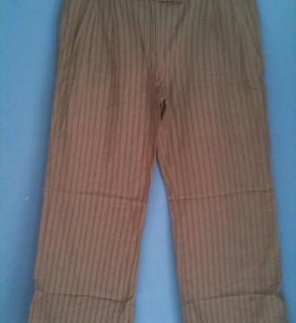 Pantalón beige a rayas de Mango T.38-40
