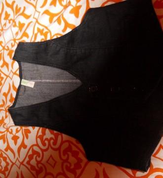 chaleco negro, usado no llega a dos veces