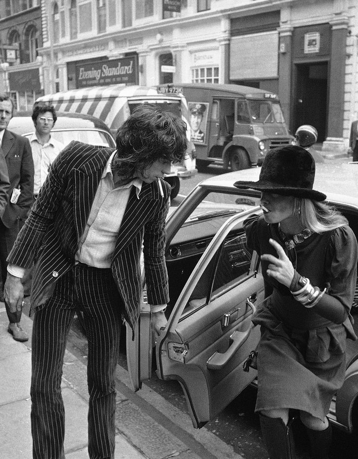 Rolling Stones Keith Richard, 29, accused of drugs and firearm charges, opens the door of car for girlfriend, actress Anita Pallenberg, 31, also charged with possessing drugs, on arrival at Marlborough Street Court in London on June 27, 1973. Appearing also with them was Polish actor Prince Jean Stanislas Klossowski. Richard was later freed on £1,000 bail. (AP Photo)