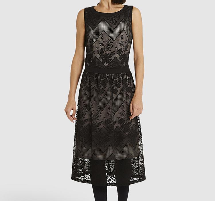 Vestidos negros para Navidad. Midi con transparencias