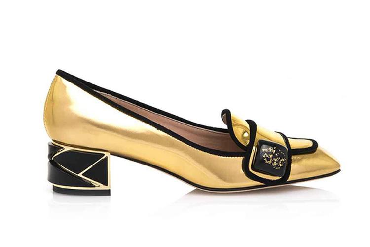 Hannibal Laguna. Zapato bicolor dorado y negro