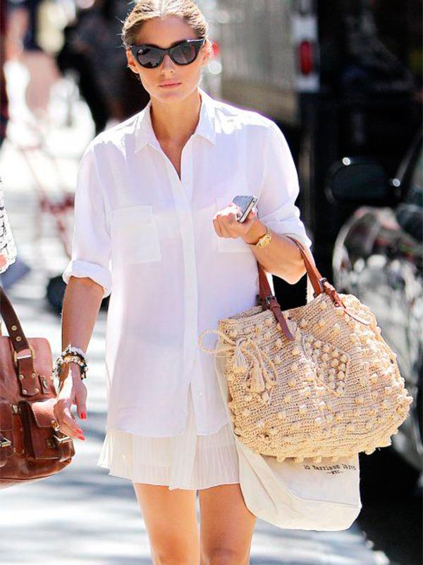 Oliva Palermo con bolsos de paja