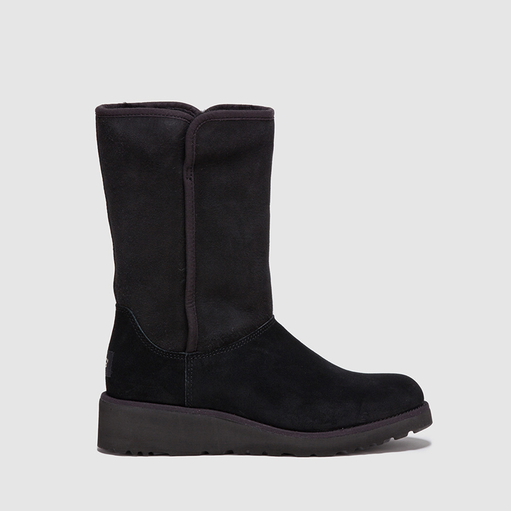 Botas de color negro con borreguito de UGG: prendas borreguito
