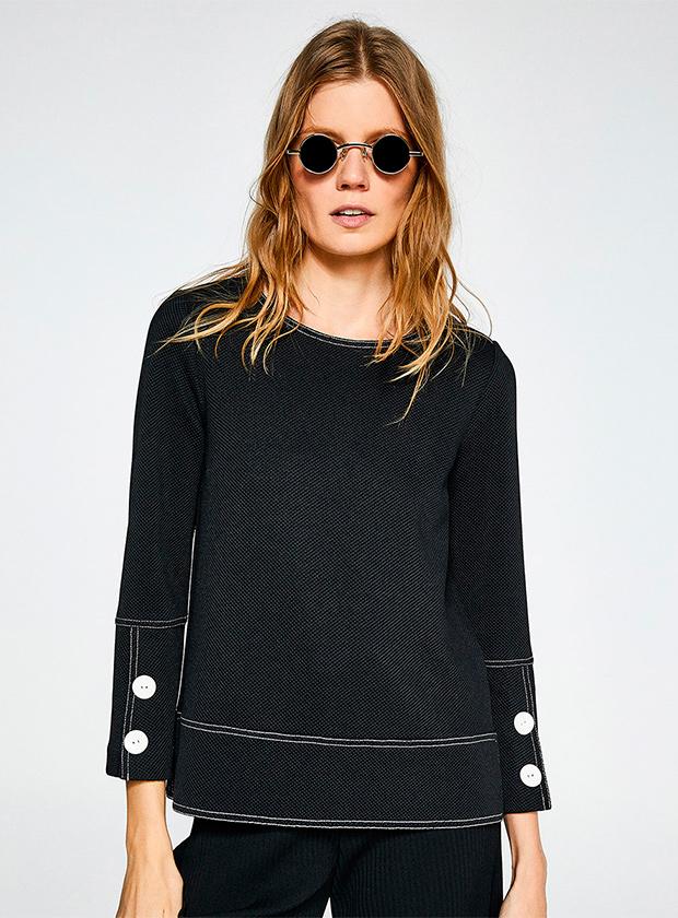 Blusa lisa de manga larga con pespuntes