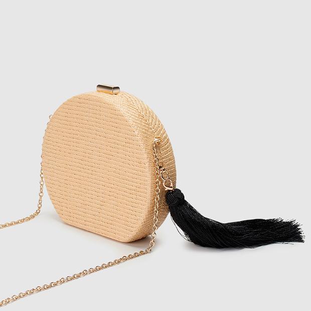 Mini bolso redondo de rafia