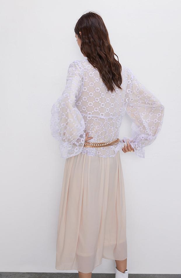 blusa semitransparente lila