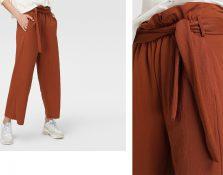 Pantalón paper bag: los diseños que te harán desear este estilo