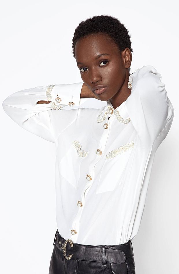 Camisa con tweed y perlas de Uterque