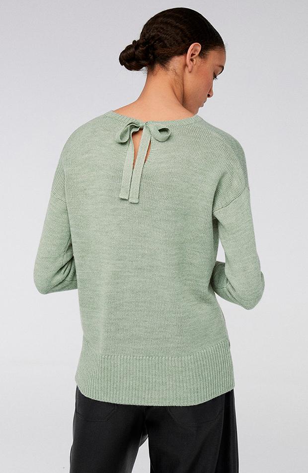 Jersey verde con lazo en la espalda de Sfera