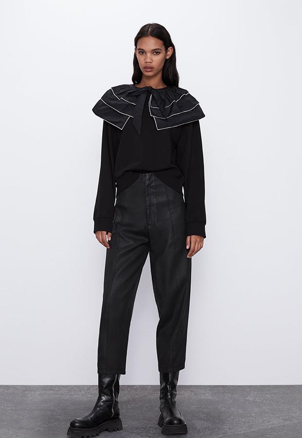 Sudadera negra con cuello de volantes de Zara
