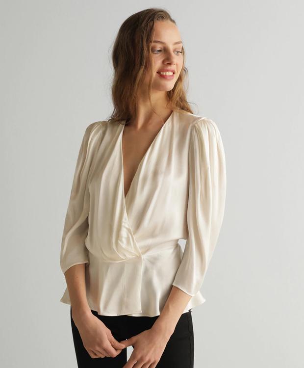 Blusa blanca por menos de 30 €