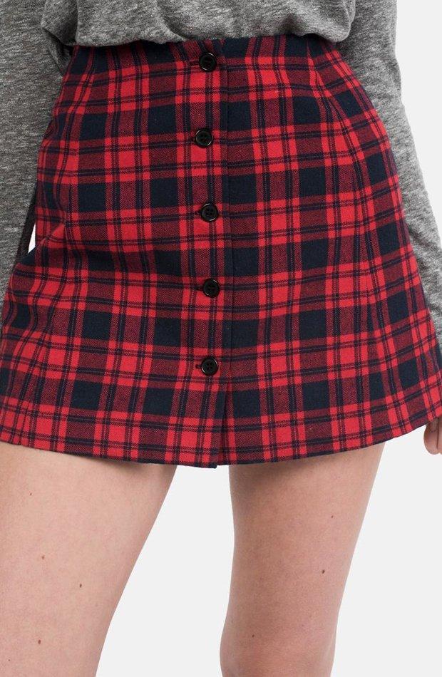 Falda de cuadros en naranja de Brownie: vuelven las minifaldas