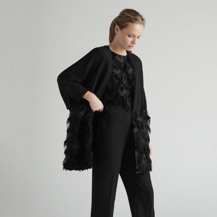 Chaqueta larga con plumas de Woman Limited El Corte Inglés: tendencias del 2019