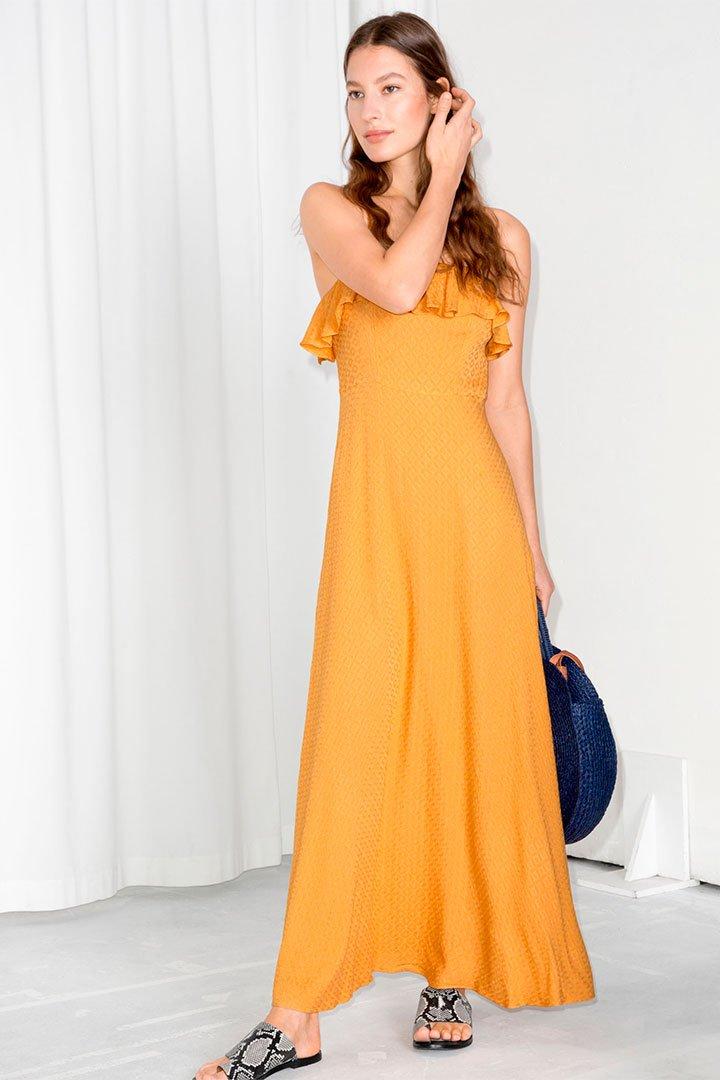 Looks de invitada en rebajas: Vestido largo amarillo