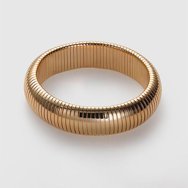 Complementos de invitada: pulsera dorada