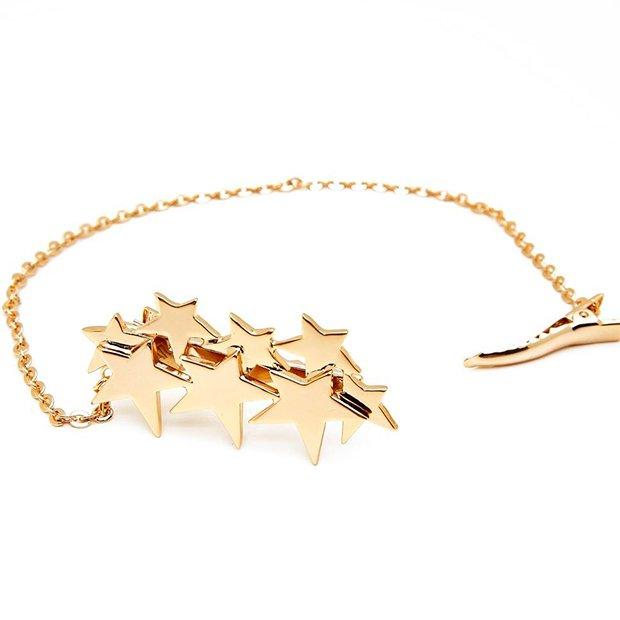 Pasador dorado con estrellas