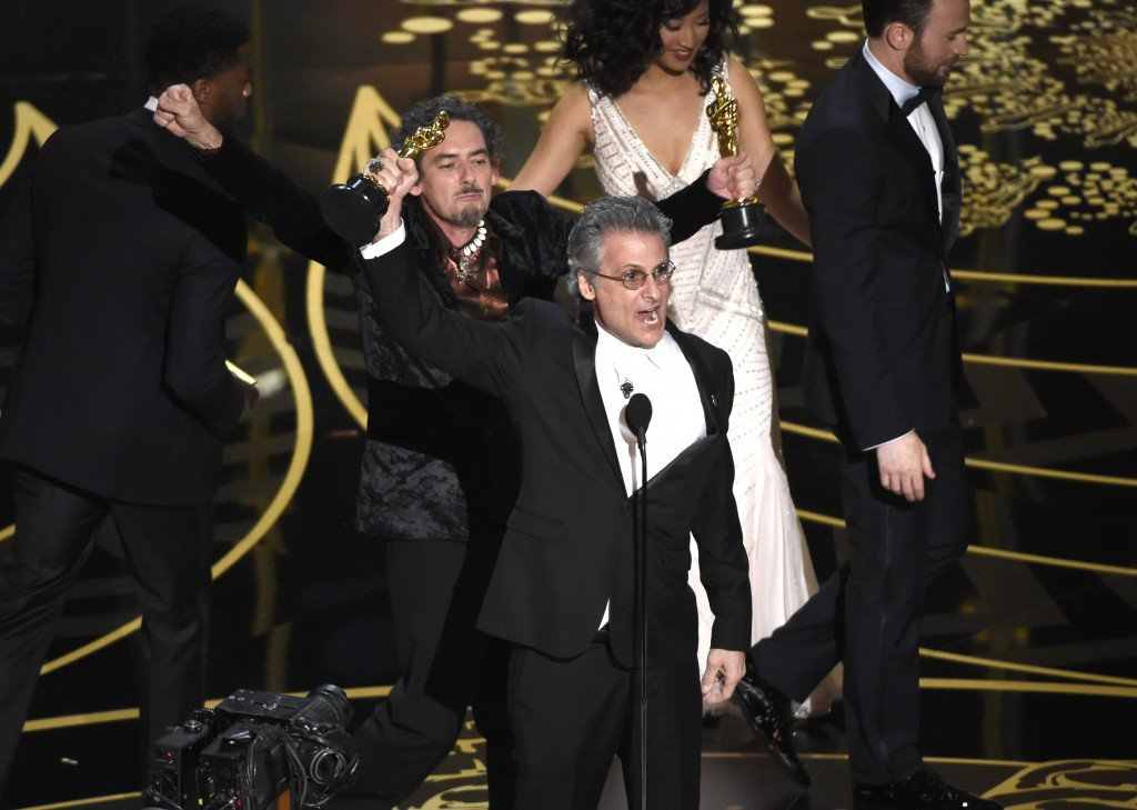 "David White, left, and Mark Mangini accept the award for best sound editing for ""Mad Max: Fury Road"" at the Oscars on Sunday, Feb. 28, 2016, at the Dolby Theatre in Los Angeles. (Photo by Chris Pizzello/Invision/AP)"