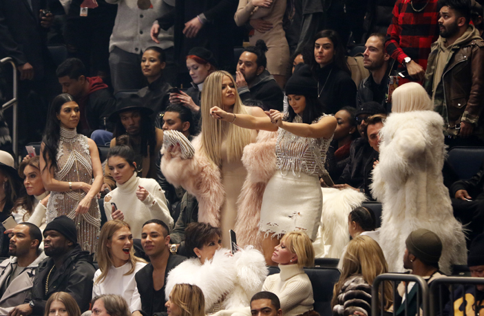 Caitlyn Jenner, second row from left, Kourtney Kardasion, Kendall Jenner, Khloe Kardashian, Kylie Jenner and Kim Kardashian West at the YeezySeason during New York Fashion Week on Thursday, Feb. 11, 2016, in New York.