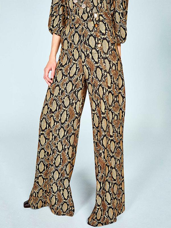 Pantalones palazzo de estampado serpiente
