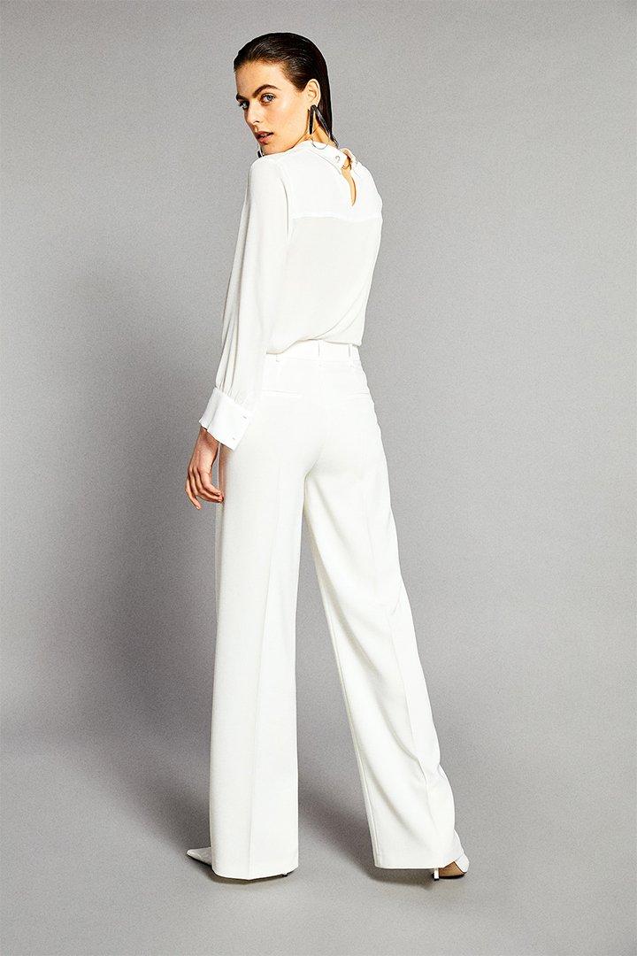 Pantalón blanco de pata ancha de Sfera Online