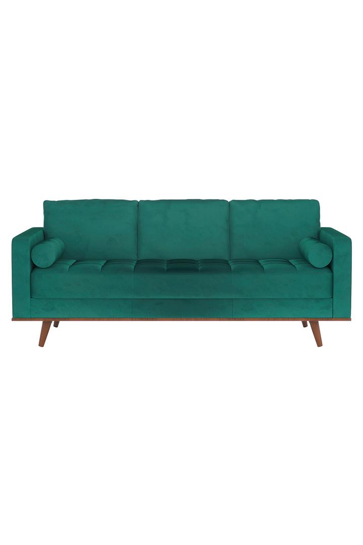 Decoración de primavera con sofá verde