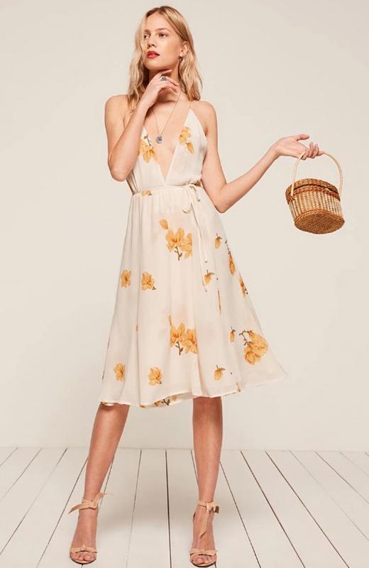 vestidos de flores con bolsos