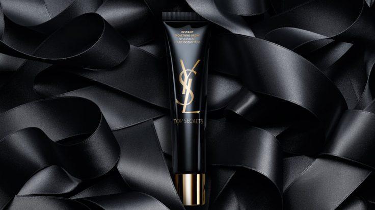 Imagen del producto instant Moisture Glow de Yves Saint Laurent con lazos negros